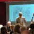 Egidio Pacella con Sante Petrocchi; seduti il preside Luciani e la professoressa Bellabarba