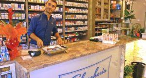 Danilo Coppari, titolare della tabaccheria sotto i portici di Piazza del Popolo