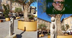 Una delle sculture in piazza e, nel riquadro, Giulio Sfrappini